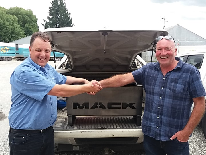 Happy Truckstops customer with his serviced Mack Truck